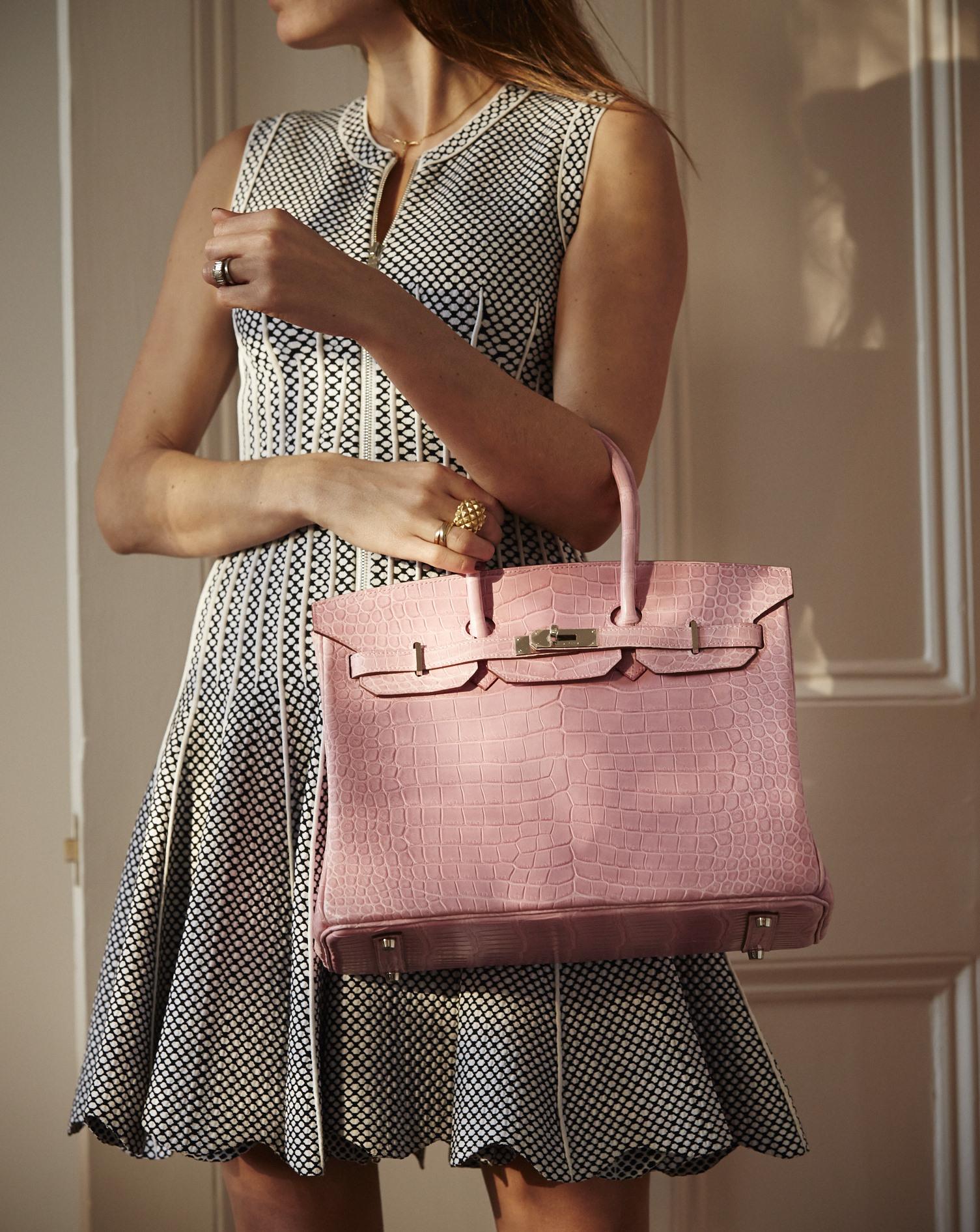 Lady holding pink Hermes Birkin bag